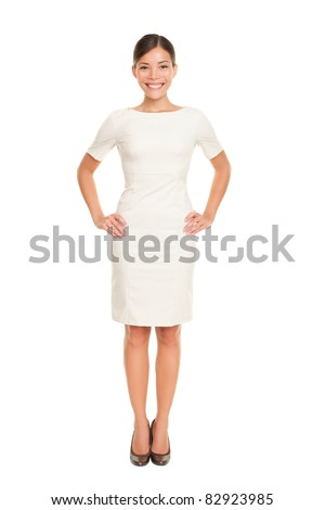 Full body woman portrait standing in business dress suit in full length isolated on white background. Beautiful young mixed race chinese asian / white caucasian businesswoman in her mid twenties - stock photo
