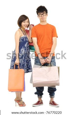 Full body young attractive woman and man going shopping with lots of colorful shopping bags. - stock photo