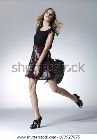 Full body young beautiful woman with bag walking - stock photo