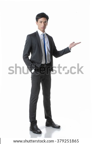 Full body young business man with arm out in a welcoming gesture