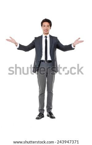 Full body young businessman shrugging - stock photo