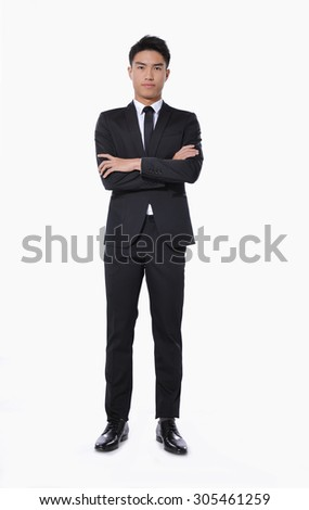 Full body young businessman with crossed arms over white background - stock photo