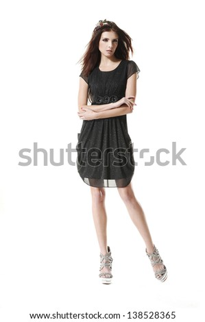 Full body young fashion model posing in black dress a studio shot - stock photo