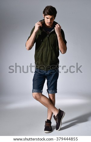 Full body Young handsome male posing in full length over light background - stock photo
