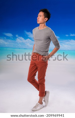 Full body young handsome man relaxing at the beach - stock photo