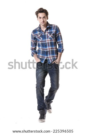 Full body Young mal model in jeans posing in the studio - stock photo