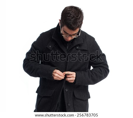 full body young man buttoning a button