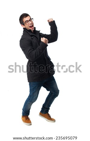 full body young man doing a winner gesture
