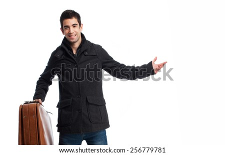 full body young man holding a leather vintage case