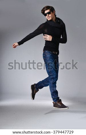 Full body young Man in Casual Clothes posing in studio