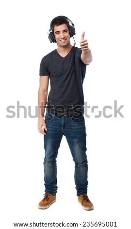 full body young man listening to music - stock photo
