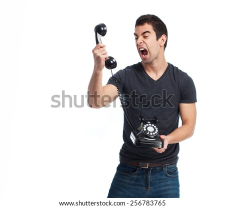 full body young man shouting to telephone - stock photo