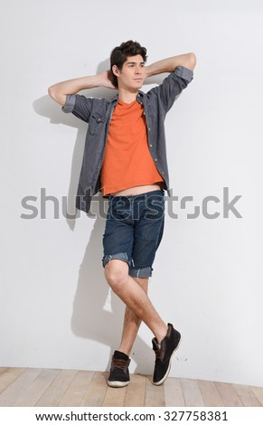 Full body young man standing over in studio - stock photo