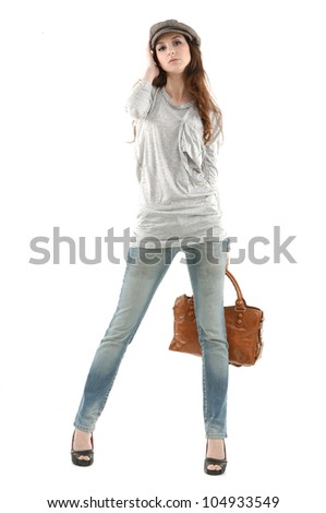 Full body young stylish brunette in glasses posing with purse - stock photo