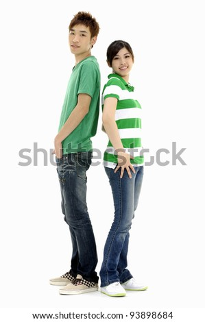 Full body young woman and man standing back to back - stock photo