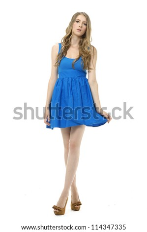 Full body young woman in blue dress. Posing Isolated