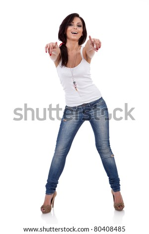 Full body young woman in casual clothes, pointing at you, isolated over a white background. - stock photo