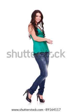 Full body young woman in casual clothes posing for the camera over white - stock photo