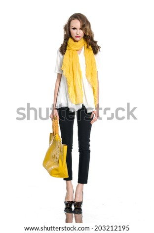 Full body young woman with scarf  holding yellow bag posing - stock photo