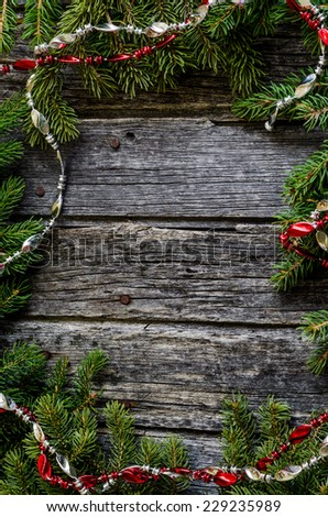 Full border of Christmas decorations of rustic wood