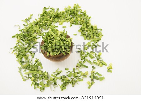 Full bowl of pandan leaf or screw pine. The long green fresh leaf is finely shredded to make herbal tea for its sweet fragrance and medicinal benefit in combat heat, treat fever, headache and cough.  - stock photo
