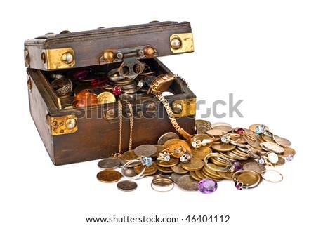 Full box of treasures isolated on white background - stock photo