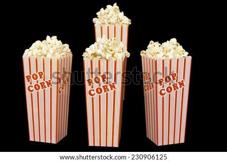 Full Boxes Of Popcorn On Black Background - stock photo