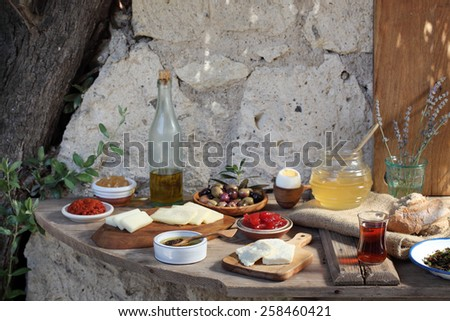 full breakfast brunch table with cheese eggs olives honey bread  - stock photo