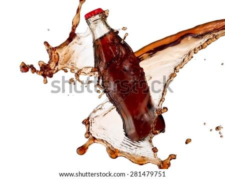 Full brown soda water bottle splash with drops - stock photo