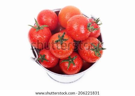Full bucket of fresh tomatoes isolated on white background - stock photo