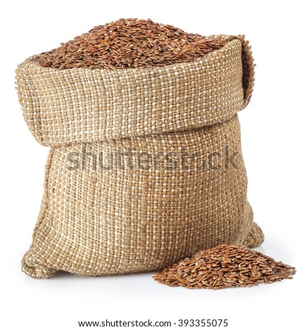 full burlap bag with flax seed and heap of flax seed isolated on white background - stock photo