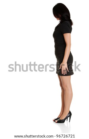 Full businesswoman looking down , isolated on white background - stock photo