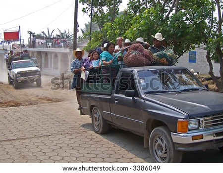 Full car of indigenous people. Guatemala - stock photo