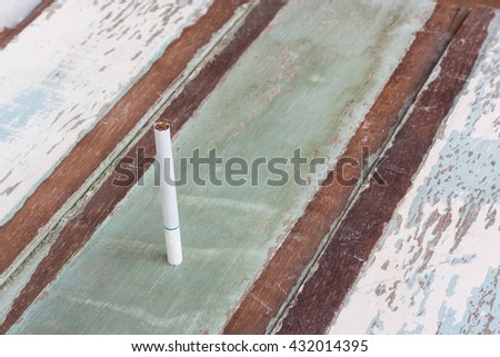 Full Cigarette Or Tobacco On Wood Background. - stock photo