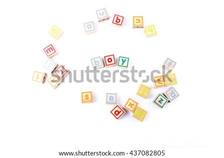 Full color Wooden toy blocks deployed boy on white background - stock photo
