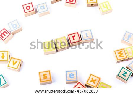 Full color Wooden toy blocks deployed girl on white background - stock photo
