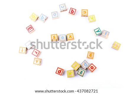 Full color Wooden toy blocks deployed sex on white background - stock photo