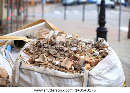 Full construction waste debris bags, garbage bricks and material from demolished house - stock photo