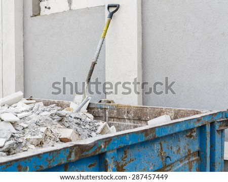 Full construction waste debris container, garbage bricks and material from demolished house - stock photo