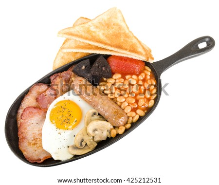 Full English Breakfast - Traditional English fry-up with egg, bacon, mushrooms, tomatoes, sausage, black pudding and baked beans. Served with slices of toast. - stock photo