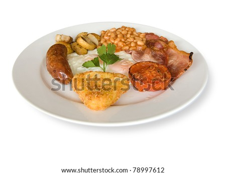 Full English cooked breakfast with bacon, sausages, fried eggs, Hash brown, mushrooms, tomato and baked beans. with a garnish of coriander. - stock photo