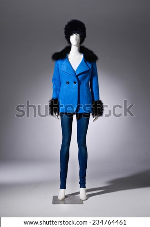Full female blue cost clothing in jeans with hat on mannequin on light background - stock photo