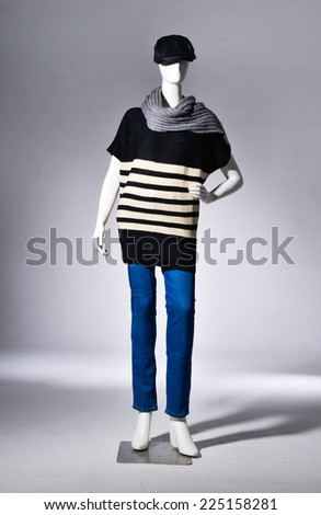 Full female clothing in jeans with black hat ,scarf on mannequin �light background - stock photo