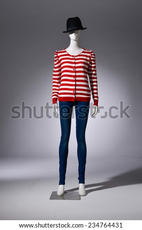 Full female striped shirt clothing in hat on mannequin-gray background - stock photo