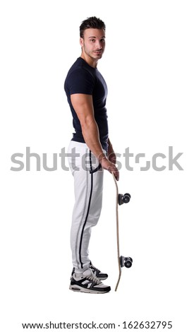 Full figure profile shot of handsome, smiling young man with skateboard, isolated on white