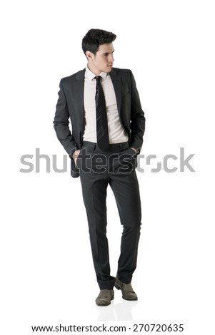 Full figure shot of handsome elegant young man with business suit and neck-tie, isolated on white, looking to a side - stock photo