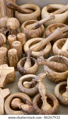 full frame background showing lots of decorative wooden tableware and kitchen equipment