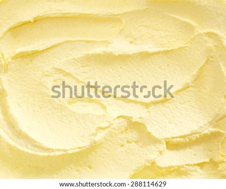 Full Frame Close Up of Banana Ice Cream, Swirled Yellow Colored Ice Cream Treat - stock photo