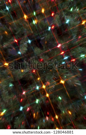 Full frame image of a Christmas tree with cluster of colorful Christmas lights. - stock photo