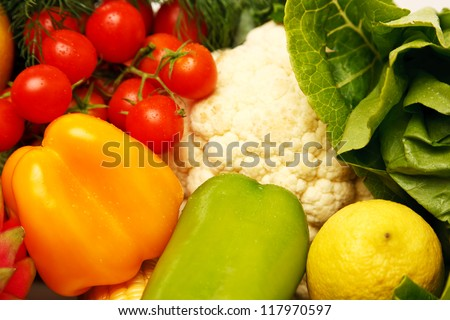 Full frame photograph of a broad variety of fruits and vegetables; colorful and plentiful.